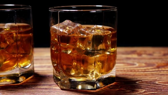 Thumbnail for Glasses of Malt Whiskey on a Wooden Table
