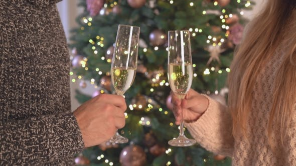 Thumbnail for Male and Female Hands Holds Goblet Bubbly Cheers.
