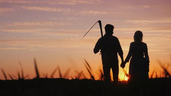 Thumbnail for Young Couple of Farmers in the Field, Enjoying the Sunset. Startup in the Agribusiness Concept