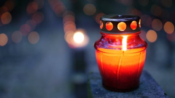 Thumbnail for Cemetery at Night with Colorful Candles for All Saints Day. All Saints' Day Is a Solemnity