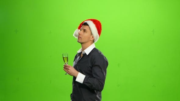 Thumbnail for Happy Smiling New Years Eve Celebrating Man with Hat on Party. Green Screen