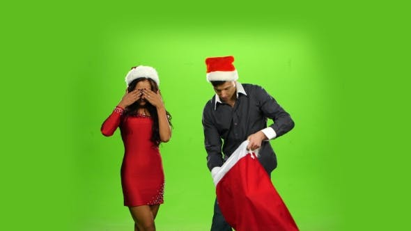 Thumbnail for Beautiful Happy Christmas Holiday Couple, Gift Box Present. Green Screen