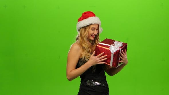 Thumbnail for Woman in Christmas Cap with Gift. Green Screen