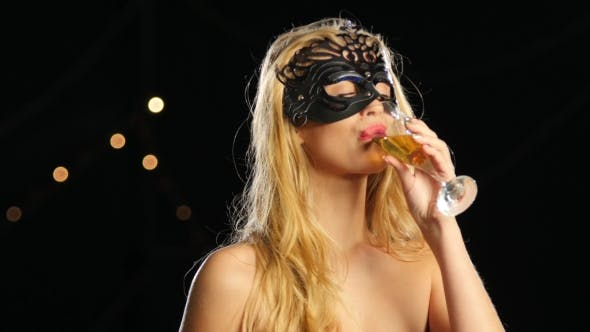Thumbnail for Sexy Blonde Woman with Venetian Mask and Glass of Champagne