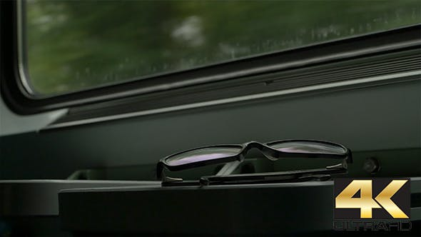 Thumbnail for Eyeglasses in the Train