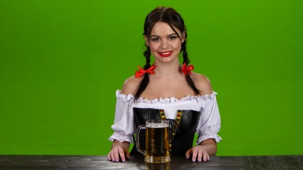 Thumbnail for Girl in Bavarian Costume Smiling and Showing Thumbs Up
