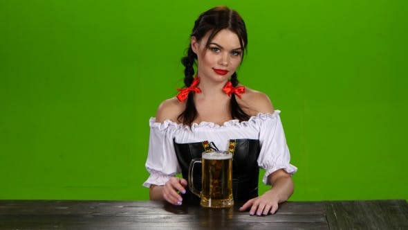 Thumbnail for Girl with Red Lips and a Bavarian Costume Serves Beer. Green Screen