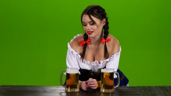 Thumbnail for Girl with Dark Hair and Flirting at Oktoberfest Offers Beer