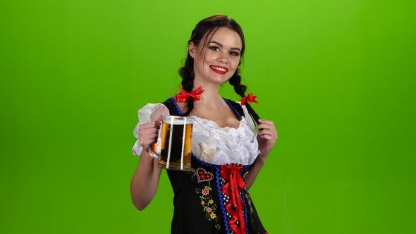 Thumbnail for Woman in Bavarian Costume Dances with a Glass of Beer in the Pickup. Green Screen