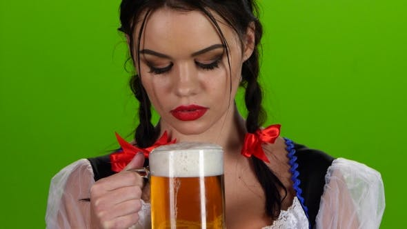 Thumbnail for Playful Girl Blowing a Glass of Beer and Smiles. Green Screen