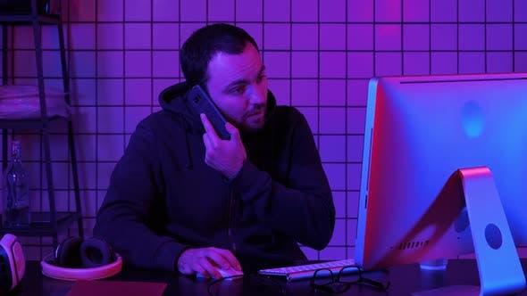 Thumbnail for Coding Specialist in Casual with Computer and Talking By Phone While Coding Information To Create