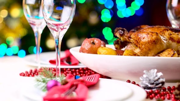 Thumbnail for Roasted Chicken on Christmas Table in Front of Fireplace and Tree with Lights