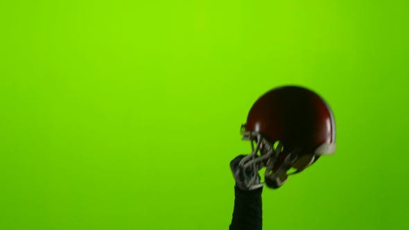 Thumbnail for Player's Hand Raises a Red Protective Helmet. Green Screen