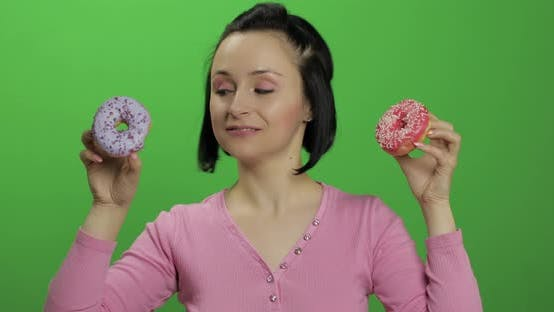 Thumbnail for Happy Beautiful Young Girl Posing and Having Fun with Donuts. Chroma Key