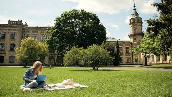 Thumbnail for Charming Blonde Student Studying Outdoors.