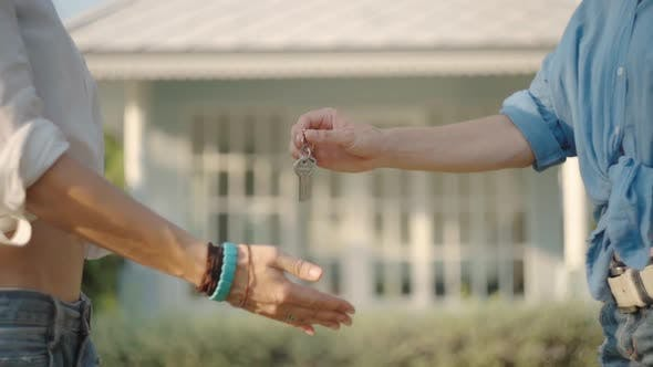 Thumbnail for Real-estate Agent Giving Keys To New Property Owners. Summer Time
