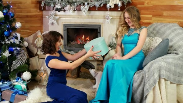 Cover Image for Friends Exchange Christmas Presents New Year's Eve, Joyful Beautiful Female Give a Gift, Girls Sit