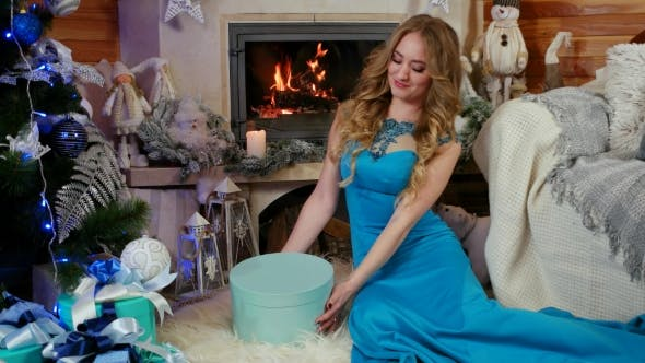 Thumbnail for Christmas Gift Young Beauty Girl Opens Christmas Gift Box with Miracle, Christmas and New Year
