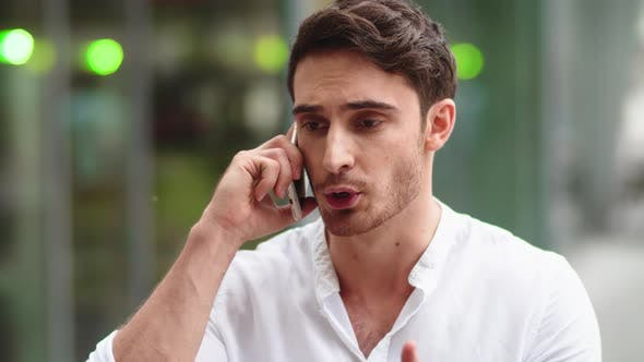 Thumbnail for Business Man Talking on Phone at Street. Guy Talking on Smartphone with Partner