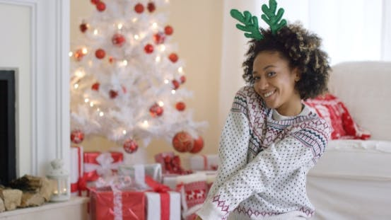 Thumbnail for Cute Young Woman Posing in Reindeer Antlers
