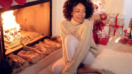 Thumbnail for Woman Seated By Fireplace and Holiday Setting