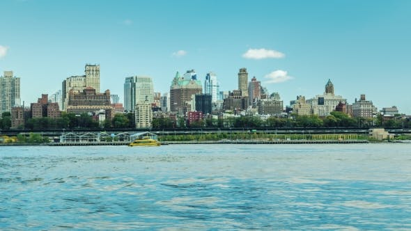 Cover Image for New York, USA: View of Brooklyn Skyline From Manhattan Across the River. Intensive Traffic on the