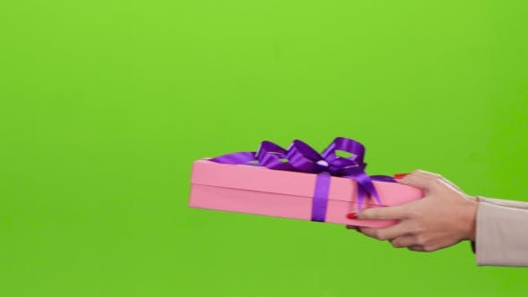Thumbnail for Gift Box. Girl Gives a Man Pink Box.