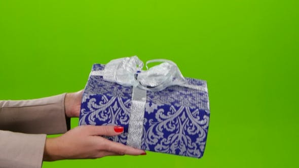 Thumbnail for Box with a Gift Lovingly Packed in Blue Paper with Ornament