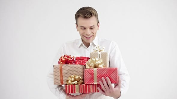 Cover Image for Man Holding Group of Gift Boxes