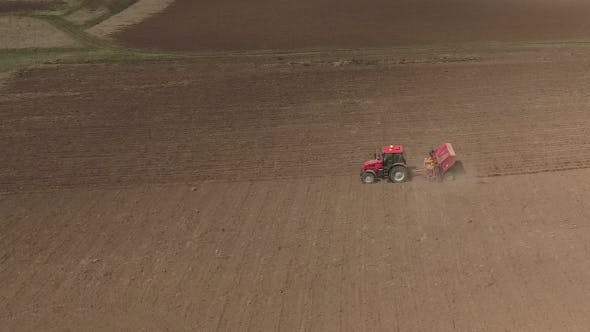 Cover Image for Aerial of Tractor on Harvest Field