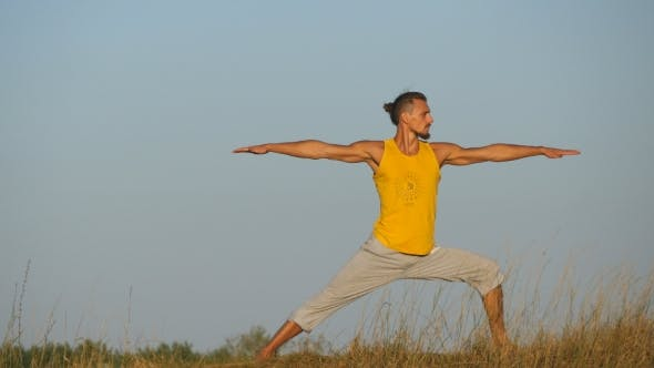 Thumbnail for Practicing Yoga Moves and Positions in Nature. Young Sporty Man Standing at Yoga Pose