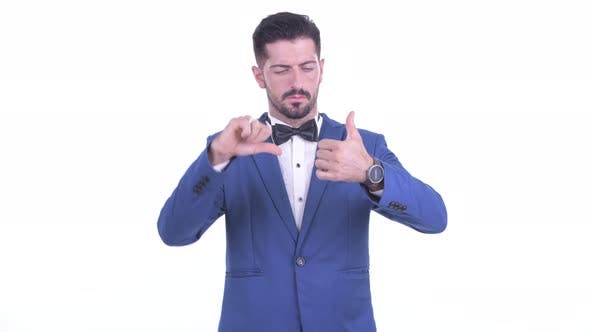 Thumbnail for Confused Young Bearded Businessman Choosing Between Thumbs Up and Thumbs Down