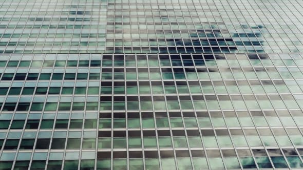 Cover Image for Glass Windows of the Building, They Are Reflected Quickly Floating Clouds