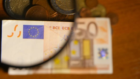 Thumbnail for Magnifying Glass Over Euro Notes