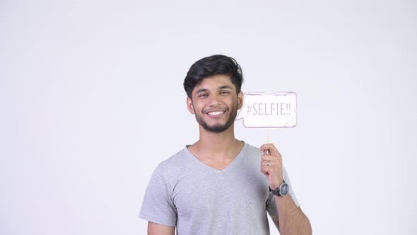 Cover Image for Young Happy Bearded Indian Man with Selfie Paper Sign