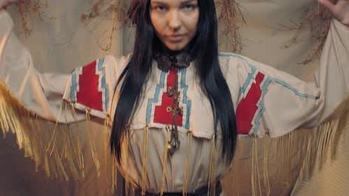 Pretty Native American Woman Is Dancing in the Wigwam,