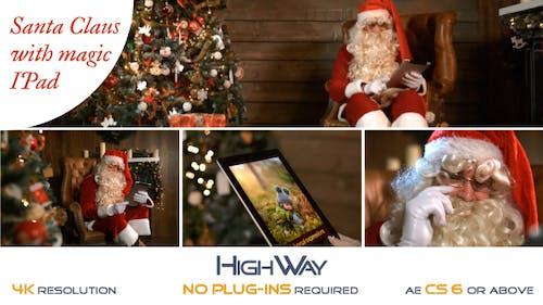 Santa Claus With Magic IPad