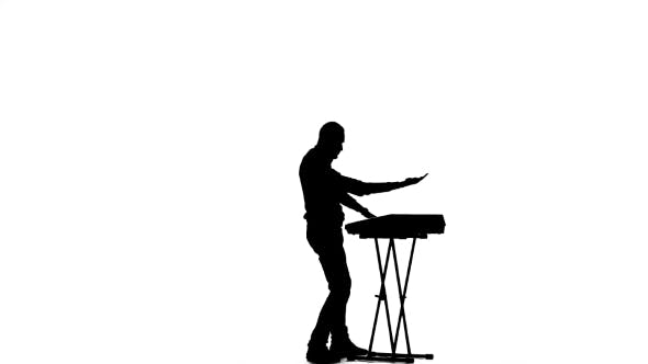 Thumbnail for Man Playing Fast Music Synthesizer. Silhouette on a White Background