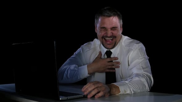 Thumbnail for Young Man Laughing at a Funny Video From the Internet