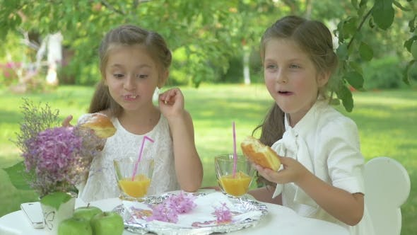 Thumbnail for The Cute Girls Eating the Donuts in the Garden