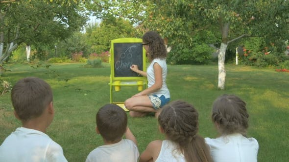 Thumbnail for The Woman Teaches the Kids in the Garden