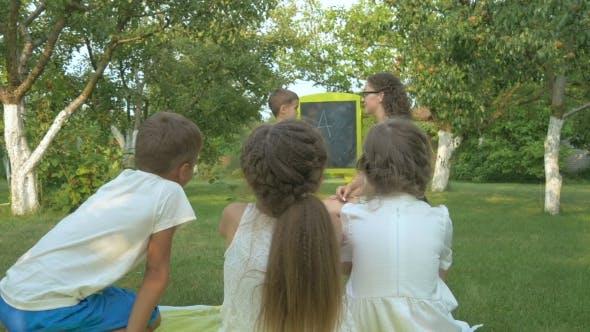 Thumbnail for The Woman Teaches the Little Children in a Garden