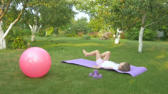 Thumbnail for The Girl Doing the Exercise in the Garden