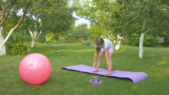 Thumbnail for A Cute Girl Doing the Exercises in the Garden