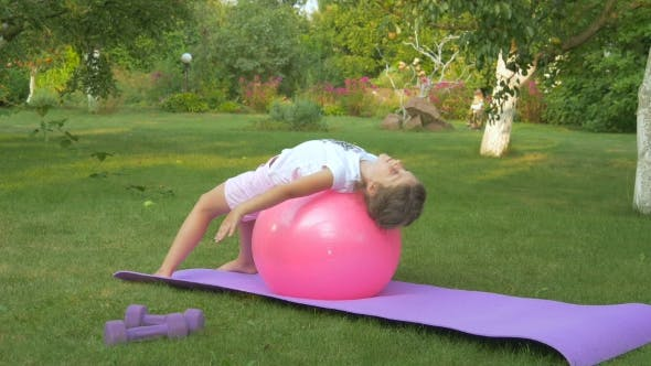 Thumbnail for The Girl Doing Exercises with Ball in Garden