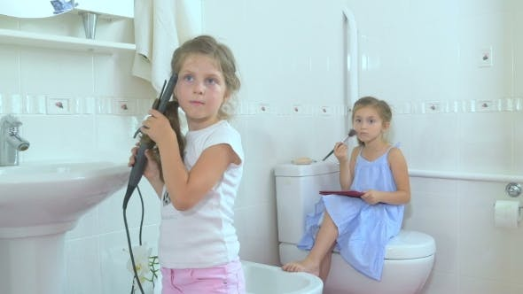 Thumbnail for Little Girls Doing the Beauty in the Bathroom