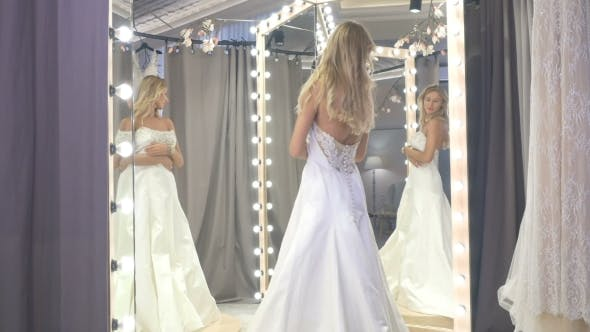 Thumbnail for The Bride Fitting Wedding Dress in the Boutique