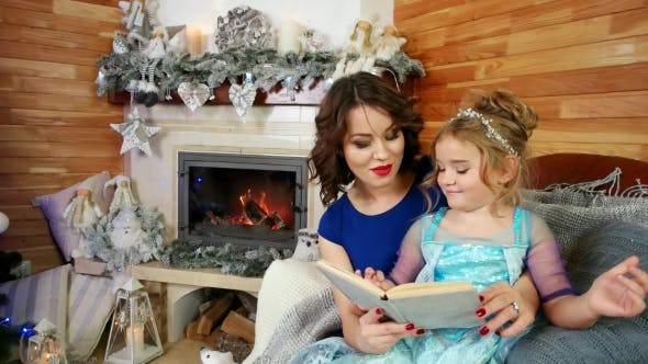 Thumbnail for New Year's Eve, Mother and Daughter Read a Book, Family Reading a Christmas Story, Sitting By the
