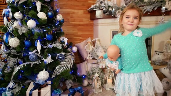 Cover Image for Little Girl Dancing with a Doll, Bobblehead, Baby Fun Celebrating New Year's Eve Near the Christmas