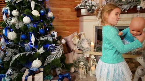 Happy Little Girl Dancing on a Christmas Holiday Near Decorations Fireplace, Little Girl Dancing